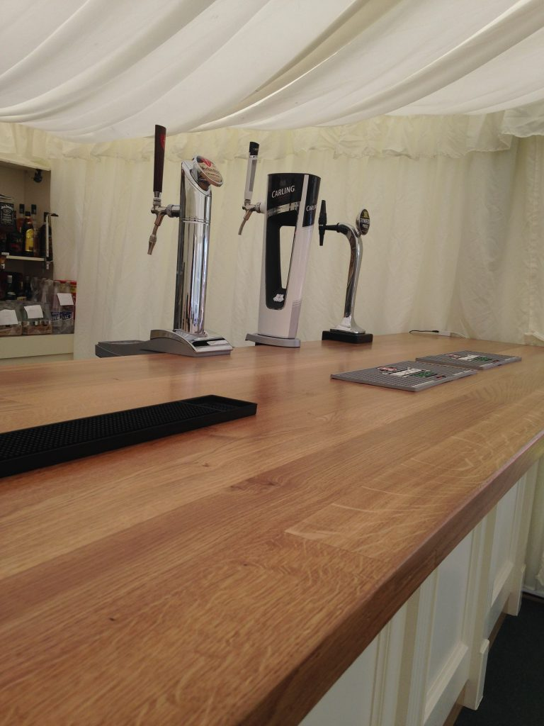 Handpainted bespoke bar with solid Oak bar top for Shropshire wedding venue